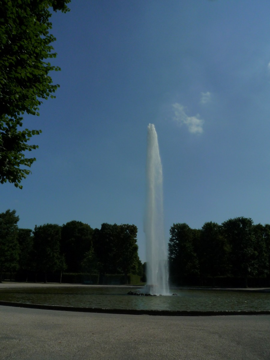 Water springs as a geyser in the largest fountain